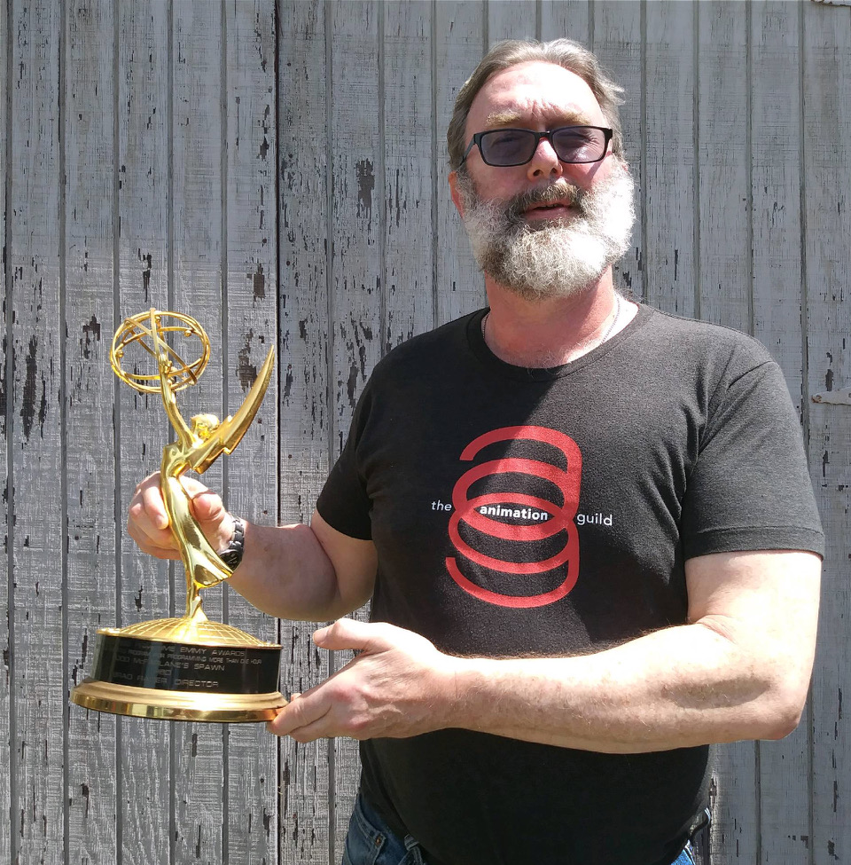 Rader holds his Emmy for Outstanding Animated Program for his work on Spawn