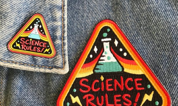 PRODUCTS: SCIENCE RULES! PIN AND PATCH  MEDIUM: Enamel (pin) and woven twill with embroidery (patch).PRICE: $8-$12