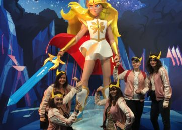 Josie with fellow writers in front of She-Ra at New York Comic-Con in 2018.