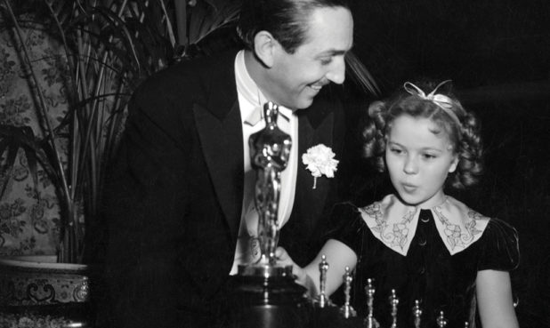 Actress Shirley Temple presents Walt Disney with a special Oscar honoring Snow White.